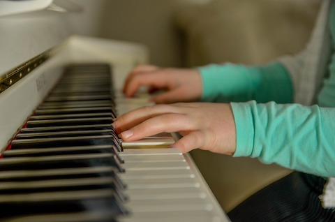 Child playing the piano in Southampton